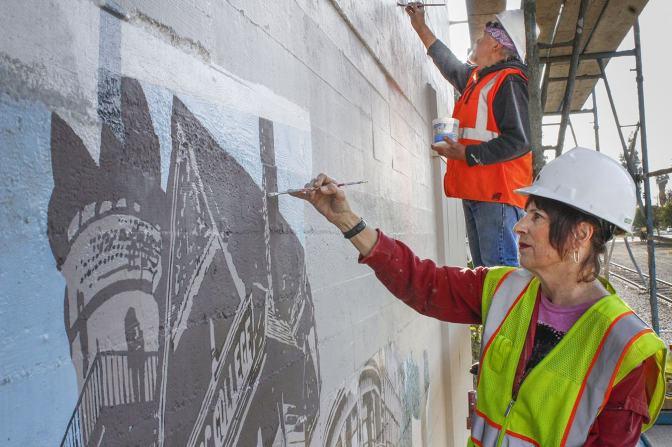 Mural restored by original artists