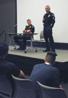 Alumni Nicholas Franco and James Cockrell watch as Baldwin Park Police Officer Andy Velebil, a La Verne alumnus, and La Verne Police Department drug recognition expert David Weaver speak to a full house about the dangers of driving under the influence Monday in the Campus Center Ballroom. Phi Delta Theta's DUI Awareness Night was created by Cockrell, who graduated in 2017, in memory of his uncle, who was killed in 2016 by a drunk driver. / photo by Natasha Brennan