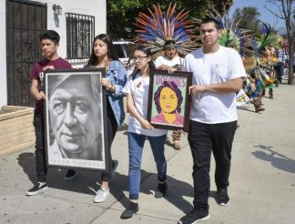 Ganesha High School senior Omar Mendez, Pomona High School senior Brenda Gomez and Garey High School seniors Melanie Andreo and Josue Garcia – recipients of the Latino and Latina Roundtable of the San Gabriel and Pomona Valleys' social justice scholarship – lead the 16th annual Cesar Chavez Pilgrimage Saturday morning. Demonstrators marched down Garey Avenue, from the Pomona Unified School District Center to Garey High School, carrying posters of American labor leaders Chavez and Dolores Huerta. Members of the Danza Azteca Toyaacan troupe and more than 100 community members attended. / photo by Natasha Brennan