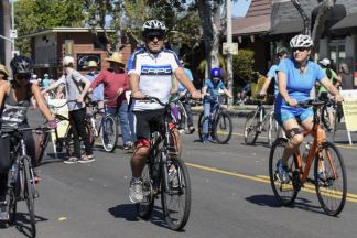 The University's Chief Financial Officer Avo Kechichian bikes down Bonita Avenue Sunday for CicLAvia: Heart of the Foothills. Thousands of cyclists and pedestrians took over the streets of San Dimas, La Verne, Pomona and Claremont for the annual event. / photo by Natasha Brennan