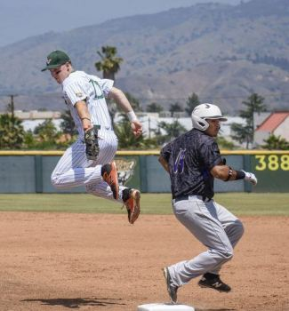 Senior first baseman Nick Michaels catches the ball mid-air as Whittier catcher Michael Angulo makes it to first during the third inning of the first game of the doubleheader Saturday at Ben Hines Field. The Leopards beat the Poets in both games on Saturday, 10-4 and 7-6. / photo by Natasha Brennan