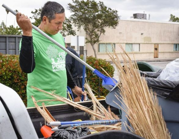 Pomona Mayor Tim Sandoval packs up cleaning supplies in a trash-filled truck at the 12th annual Pomona Beautification Day Saturday. Hundreds of residents and volunteers from the community worked together at 33 project sites from 8 a.m. to noon. Volunteers picked up trash, planted trees, helped start community gardens and created what is soon to be Pomona's first wilderness trail. / photo by Natasha Brennan
